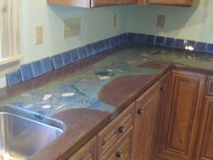 Day 6 - Crushed granite aggregates are versatile and provide a beautiful decorative accent to any concrete countertop. DCI offers many glass and stone colors and sizes to choose from! Concrete Countertops Over Laminate, Formica Countertops, Cement Counter, Beton Design, Concrete Design, Acid Stained Concrete, Stain Concrete, Concrete Kitchen, Painting Concrete