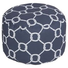"""Showcasing an ivory rope motif laid over a navy backdrop, this eye-catching pouf lends nautical appeal to your living room or den.  Product: PoufConstruction Material: PolyesterColor: Navy and ivoryFeatures: Made in the USASuitable for indoor or outdoor useDimensions: 13"""" H x 30"""" DiameterCleaning and Care: With a dry cotton towel or white paper towel, blot out stain as much as possible. Scrape off any debris.  Blot area with a dry towel."""