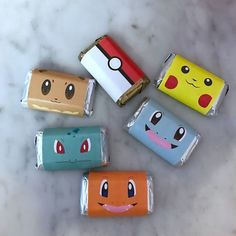 Pokémon candy wrappers around mini chocolate bars as party favors for a Pokémon-themed birthday party. Click or visit FabEveryday.com to see details and DIY instructions for a Pokémon or Pokémon Go themed kid's party, including printables, food, decorations, favors, and party activities.