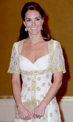 As is customary for Kate, the piece showcased an homage to her host country: that glittering gold embroidery is a hibiscus, the official flower of Malaysia.