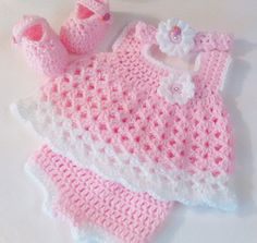 THIS BEAUTIFUL NEWBORN BABY DRESS SET WAS MADE WITH TOP QUALITY, ULTRA SOFT BABY YARNS. THE PERFECT BABY SHOWERGIFT OR TAKE BABY HOME LAYETTE . THIS SPRING/SUMMER NEWBORN DRESS SET IS SO FRILLY WITH SPRINGTIME FLOWERS. CROCHETED IN BABY PINK AND WHITE. SET INCLUDES FRILLY DRESS WITH BLOOMERS, MARY JANE BOOTIES AND A CUTE LITTLE HEADBAND. PRETTY LITTLE LADY BUG BUTTONS.   THIS LISTING IS MADE UP IN BABY PINK AND WHITE.  THIS SET CAN BE MADE IN CUSTOM COLORS OF YOUR CHOICE.  NEWBORN DRESS…