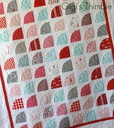 Snickerdoodle quilt - uses charm squares for quarter rounds.