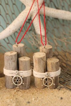 """Holiday craft possibility , use driftwood for """"Piers"""". jute or thin white rope (or paint it if necessary) and """"charms"""""""