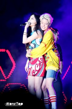 "SNSD TaeYeon and Fx Amber performing ""Shake That Brass"" at SMTown. So Cute!!"