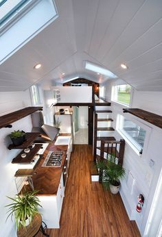 Inside the custom Napa Edition are white walls, ceiling, and cabinetry. Rich wood finishes contrast the white and add warmth to the home. house design Custom Napa Edition by Mint Tiny Homes - Tiny Living Tiny House Cabin, Tiny House Living, Tiny House Plans, Tiny House Design, Tiny House Bedroom, House And Home, Open Plan House, Tiny House Kitchens, Tiny Home Floor Plans