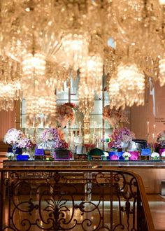Crystal chandeliers and bouquets at Olivia Palermo's gorgeous, feminine dinner party in Paris