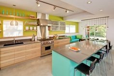 I like the concrete floor, slate countertop, stove backsplash, lights over the dining table, and surprisingly, the lime and turquoise wall colors!