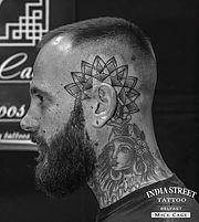 Head Mandala Tattoo by Award-winning tattoo artist specialising in Dotwork, Tribal and Geotmetric tattooing at India Street Tattoo, Belfast, Northern Ireland.