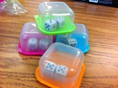 Mini food storage containers used to contain dice. Great for dice games in the classroom.
