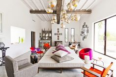 Living room with neutral daybed and vibrant pink armchairs