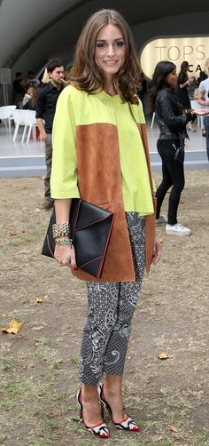 Olivia Palermo's black-and-white print anchored her colorful, textured outfit at London Fashion Week.