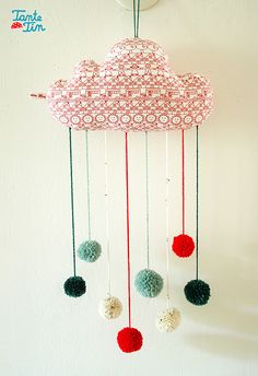 DIY ~ Pom Pom Cloud @Marian Towell I reckon you'd love something like this? Pom poms and clouds, excellent combo!