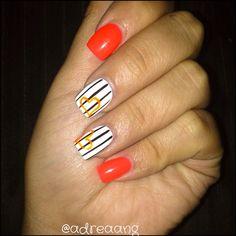Orange with Black and White Strips and Orange Heart Nail Art Design