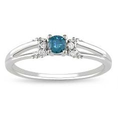 Little bitty blue and white diamonds. Seems subtle and cute. Possibly my hand would drown it.