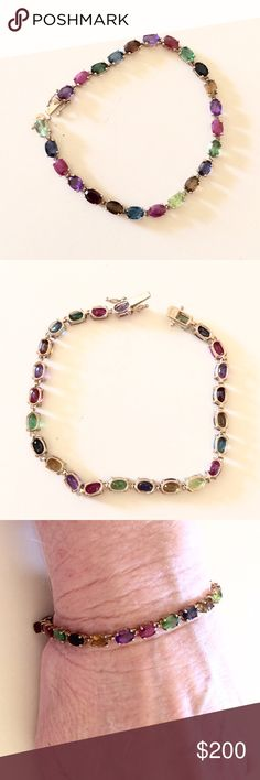 10k multi-gemstone bracelet This is a 7 inch 10k yellow gold bracelet with insert clasp. It has all natural gemstones. Ruby, sapphire, tourmaline, amethyst, peridot, London blue topaz. I had it custom made. Sadly it will be going to a jeweler if it doesn't sell fast.  I don't have any papers of authenticity. Jewelry Bracelets