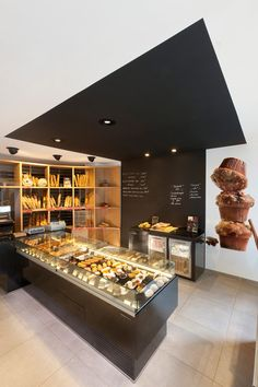 Inviting Bakery Design in France by Cruz, S.L.: Boulangerie Gourmande. Interesting use of colour on the ceiling
