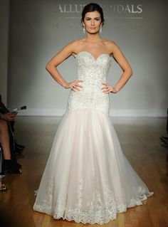 Allure fall 2016 wedding gown with sweetheart neckline and intricate beaded bodice with drop waist blush skirt with lace details | https://www.theknot.com/content/allure-wedding-dresses-bridal-fashion-week-fall-2016