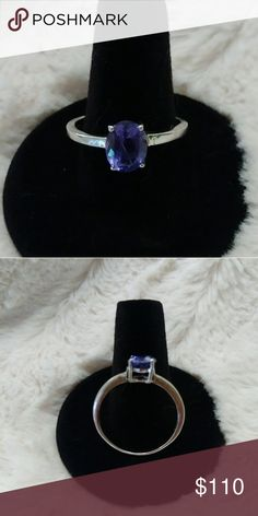 2 Carat Genuine Tanzanite Ring 2 Carats of Beautiful Genuine Tanzanite from the Maralani mines set in Sterling silver.  Dark Blue-Purple with flashes of red. Internal flaws hidden by depth of color. From my own collection. Size 10. Questions? Please ask. NO Low Ball Offers Accepted. Jewelry Rings
