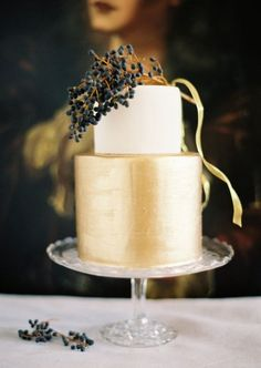 a simple yet stunning wedding cake design with gold and white