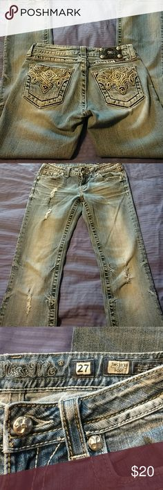 Miss Me Bootcut Jeans Good Condition.  Light wash, distressed denim.  Three holes on right leg, one hole in left leg.  Small black stain above left back hem. Slight stretch.  Fit slightly smaller than my other size 27 jeans. Miss Me Jeans Boot Cut