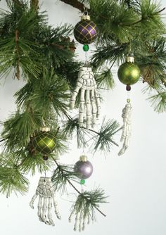 Cheap plastic skeletal hands work as ornaments--SOOO going to make a bunch of these. Halloween Christmas Tree, Dark Christmas, Halloween Ornaments, Halloween Town, Holidays Halloween, Christmas Themes, Halloween Crafts, Christmas Crafts, Christmas Bulbs