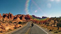 Following Jessica past the spires and windows of Arches National Park in the cool sunshine of late October. This area was featured in the October 2014 issue of Rider magazine.
