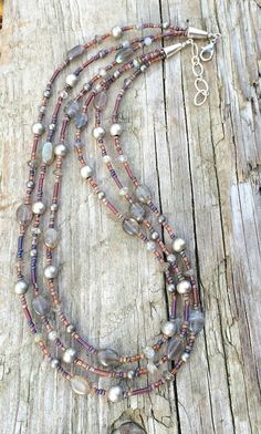 """Hand beaded strands with rustic Czech glass beads, labradorite and antiqued silver plated beads. Earthy colors and light weight. Adjustable between 17-18"""" in length"""