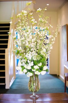 white flower arrangement by Pomp and Splendour