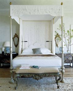 An oceanside estate in Malibu, California, got a glamorous makeover courtesy of Michael S. Smith. The four-poster in the master bedroom is by John Robshaw Textiles; the decorator topped it with a canopy embroidered by Ankasa. The bedside chests are Japanese, and the reading lamps are by Visual Comfort & Co.