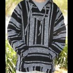 Poncho.  Comfy black and white poncho. Was handmade in Mexico and only worn once. Super warm and comfy. Size small. Sweaters Shrugs & Ponchos
