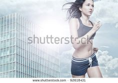 stock photo : Young woman running in front of urban style