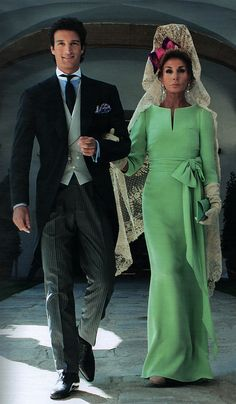 Rafael de Medina, 20th Duke of Feria and his mother Natividad Abascal in a unique haute couture Valentino sea-foam green silk crepe gown with bateau neckline, 3/4 sleeve and waist-tie bow; hair styled with a Spanish mantilla peineta.