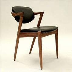 Kai Dining Chair - Stunning around a long rectangular old wood dining table.