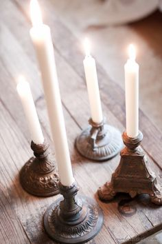 Collection of vintage, ornate candle holders with white taper candles. - the curious bumblebee