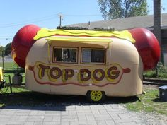 Top Dog is a crazy hot dog shaped Airstream trailer that parks along Route 66 in Portland, Connecticut.
