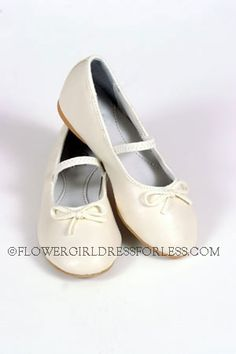 Fancy ballet with stretchy strap top strap that secures the shoe.  They have a tiny heel with hard soles,.great value shoe that can be worn again and again,.shoes are so cute with any outfit,.truly fit for a ballerina princess!   Available in all sizes -See S26 for the baby and toddler sizes.  Measurements were taken INSIDE shoe from toe to back-  Size 9- 7 inches, Size 10- 7 1/4 inches, Size 11- 7 1/2 inches, Size 12- 8 inches, Size 13- 8 1/4 inches, Size 1- 8 1/2 inches, Size 2- 8 1/2…