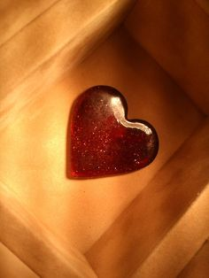 This is a heart in a box. Heart is made only of resin from spruce mixed with red glitter. = ) It's my version of Davy Jones's Locker =D