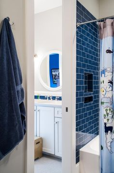 Loving the punch of blue in this bathroom design. Click the image to see more! #interiordesign #subwaytile #kidsdesign #collectiondesignlifestyle Blue Subway Tile, Modern Farmhouse Interiors, Shower Niche, Oak Hill, New Construction, Color Pop, Bathrooms, Interior Design, Storage