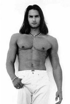 Could easily be a character in one of my worlds. Gotta love the hair. And muscles.   Marcus Schenkenberg
