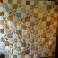 The Hunter's Star is an impressive variation of a normal star quilt pattern created with half square triangles and charm quilt patterns. With warm fabric colors, this can be a rustic addition to any room.