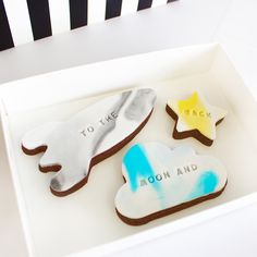 to the moon and back biscuits   Delicious handcrafted chocolate sugar cookies.  Three beautiful chocolate sugar cookies made with the finest ingredients. Beautifully packaged in a white gloss gift box with a black and white stripped ribbon. A perfect gift for a loved one, 'I love you to the moon and back'.