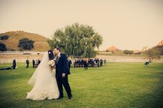 Rustic Vintage Wedding Vineyard- Love this shot of bride and groom with guests in background