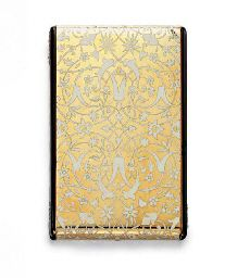 AN ART DECO ENAMEL, DIAMOND AND GOLD CASE  Designed as a polished 18k gold rectangular case decorated with an overall floral pattern in cloisonné white enamel, the sides with oval-shaped pavé-set diamond plaques and hidden pushpiece, opening to reveal a fitted mirror and a closed and open compartment, mounted in 18k gold, circa 1930, 3 x 2 x 3/8 ins., with French assay marks, Christie's.