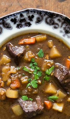 Irish Beef Stew ~ Beef stew made with beef, garlic, stock, Irish Guinness stout, red wine, potatoes, carrots, and onions. A hearty stew perfect for celebrating St. Patrick's Day! On SimplyRecipes.com
