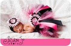 newborn wearing a tutu. Love the bright pink and black combo