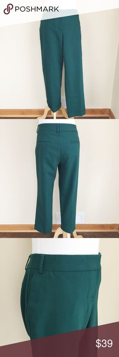 "Express Editor green cropped pants sz 8 Express Editor green cropped pants, size 8.  Lower rise, tapered legs, wide waistband, zip and hook closure, cuffed hems, rear pockets are still sewn shut, smooth stretchy material.  Condition:  excellent pre-loved.  Material: 49% polyester/47% cotton/4% elastane.  Measurements (approximate, taken laying flat): length 34"", inseam 26"", rise 9"", flat waistband 16.5"", flat hip 19.5"". Express Pants Ankle & Cropped"
