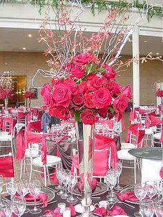 wedding centerpiece photos - tall red rose and orchid centerpiece