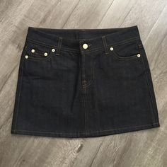"""Coach NWOT denim mini skirt Coach NWOT denim skirt. 100% cotton dark denim miniskirt. 5 pocket styling with Gold Coach rivets. Sizing tag has been removed, waist measures 14.25"""", hips 17.5"""", length 13.25"""". Fits about a size 0-2, double check measurements for best fit assurance. New without tags, never worn. Great designer skirt! Coach Skirts Mini"""