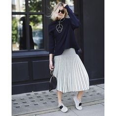 @camtyox kept things playful in pleats, a circular statement necklace and the perfect pair of classic chic kicks for a day full of shows -LTKTakeoverTuesday, #LTKxPFW edition   Shop her #PFW street style with www.LIKEtoKNOW.it   www.liketk.it/1MHUS #liketkit