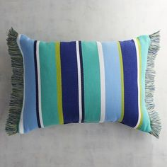 Designed to coordinate with our colorful Cabana Collection, our yarn-dyed Parker pillow is an ottoman weave that has a ribbed effect. Trimmed with fringe, it is resistant to UV rays, mold and mildew.